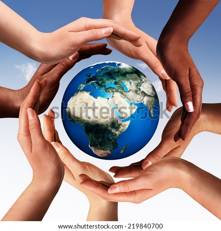 Conceptual peace and cultural diversity symbol of multiracial hands making a circle together around the world the Earth globe on blue sky background. Elements of this image furnished by NASA. - stock photo