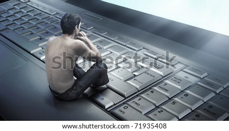 Conceptual photo of a young man addicted to the internet - stock photo