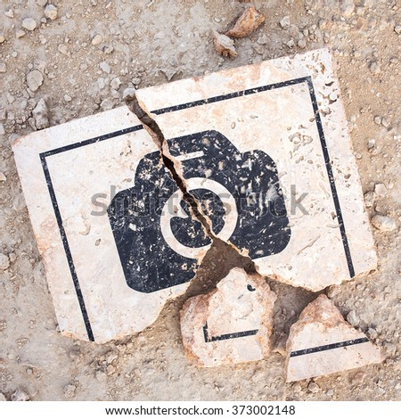Conceptual photo of broken photo sign. Photography not allowed. Photographu prohibited sign  - stock photo