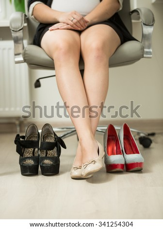 Conceptual photo of businesswoman choosing comfortable shoes instead of high heels - stock photo