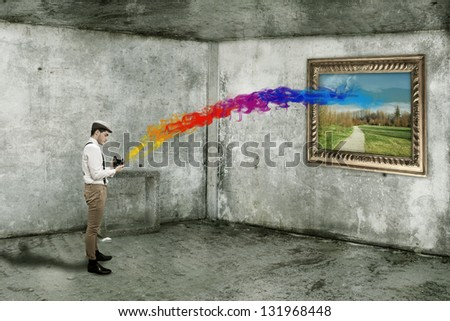 Conceptual photo of digital photographer shooting in color