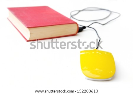 Conceptual photo with old book and computer mouse - stock photo