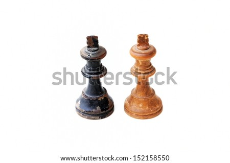 Conceptual photo with old chess pieces (black and white kings) - stock photo