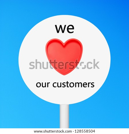 conceptual picture regarding business customer care saying we love our customers (against a blue sky background) - stock photo
