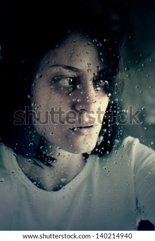 conceptual portrait of stressed abused young woman - stock photo