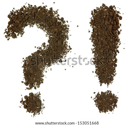 Conceptual question mark and exclamation mark made of soil - stock photo