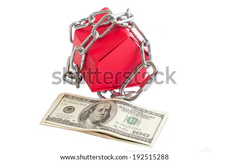 Conceptual red house locked with chain and money on white background - stock photo