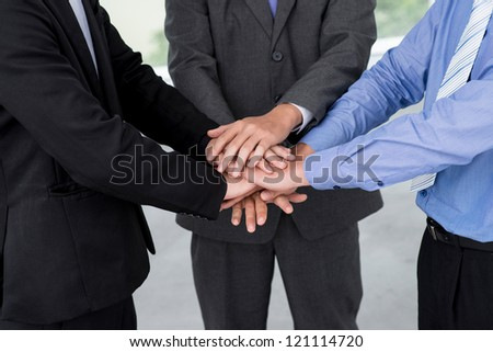 Conceptual shot of a business team forming bonds - stock photo