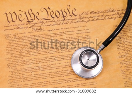 conceptual shot of the US constitution and stethoscope - stock photo