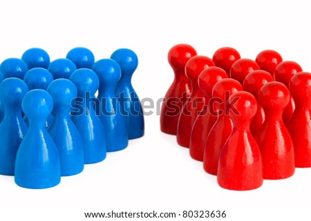 Conceptual shot showing to groups facing each other symbolizing the concept of division, conflict, polarization (i.e. between Democrats and Republicans), but also an increasing gender gap