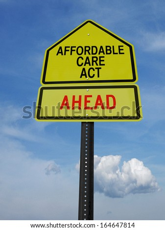 conceptual sign with words affordable care act ahead over blue sky - stock photo