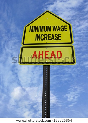 conceptual sign with words minimum wage increase  ahead over blue sky - stock photo