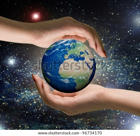 "Conceptual symbol  human hands surrounding the Earth globe.  Isolated on white background. ""Elements of this image furnished by NASA"" - stock photo"