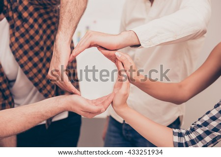 Conceptual symbol of cooperation diverse hands making a circle. People help each other - stock photo