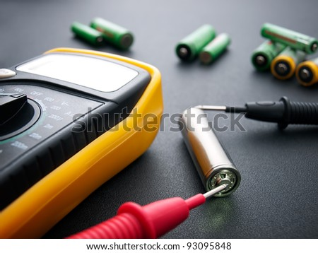 Conceptual view about battery testing with electrical multimeter...