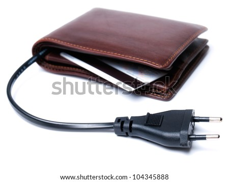 Conceptual view of a wallet with the cable and plug as a symbol of consumption. - stock photo