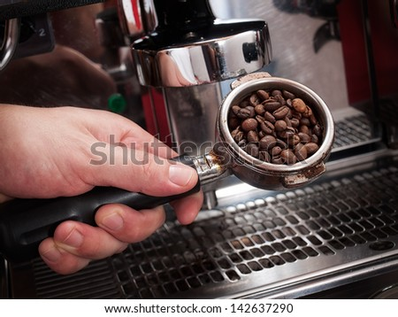 Conceptual view of making espresso coffee with professional coffee machine - stock photo
