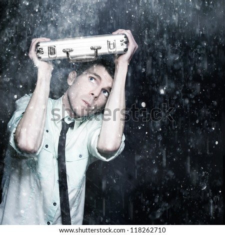 Concerned Business Person Hiding Under A Work Briefcase While On The Run From Bad Weather A Depiction Of Business Struggle - stock photo