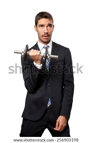 Concerned businessman holding a dumbbell - stock photo