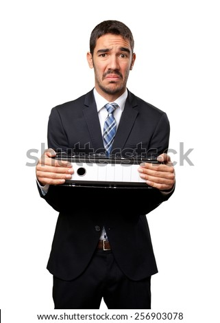 Concerned businessman holding files - stock photo