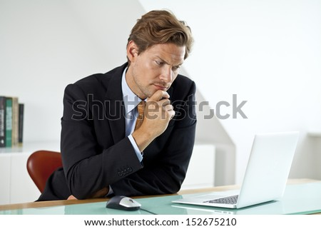 Concerned Businessman Wondering about something - stock photo
