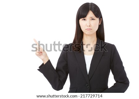 concerned businesswoman pointing side