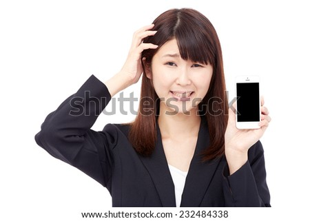 concerned Japanese businesswoman with the smart phone - stock photo