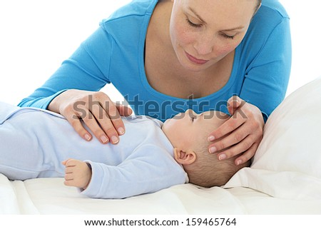 concerned mom has her baby seems not feeling well - stock photo