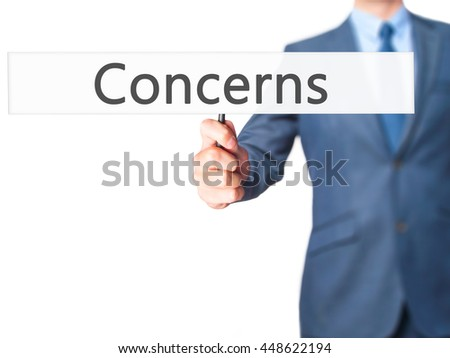 Concerns - Business man showing sign. Business, technology, internet concept. Stock Photo - stock photo