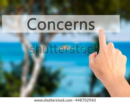 Concerns - Hand pressing a button on blurred background concept . Business, technology, internet concept. Stock Photo - stock photo
