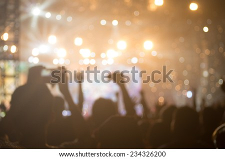concert background, hand up , blurry background, beautiful bokeh live concert - stock photo