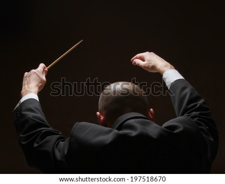 Concert conductorwith a baton - stock photo