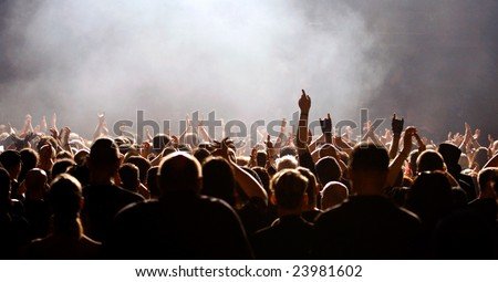 Concert crowd, Fans raising hands white light