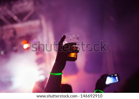 Concert Crowd in front of stage-lights - stock photo