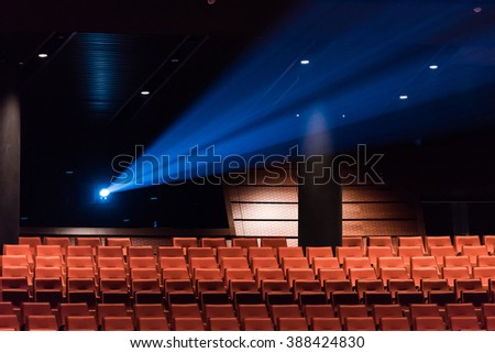 Concert hall seats with rear light projection.