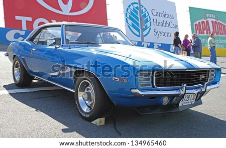CONCORD, NC - APRIL 6:  A 1969 Chevrolet Camaro Z/28 on display at the Food Lion Auto Fair classic car show at Charlotte Motor Speedway in Concord, NC, April 6, 2013. - stock photo