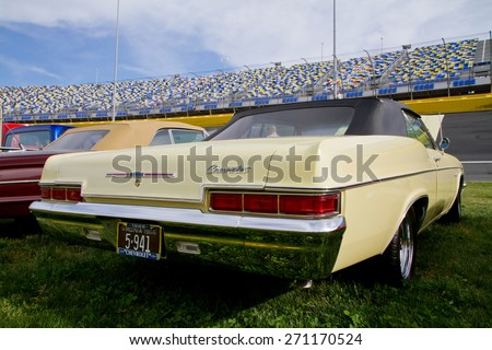 CONCORD, NC -- APRIL 11, 2015:  A 1966 Chevrolet Impala convertible automobile on display at the Charlotte AutoFair classic car show held at Charlotte Motor Speedway. - stock photo