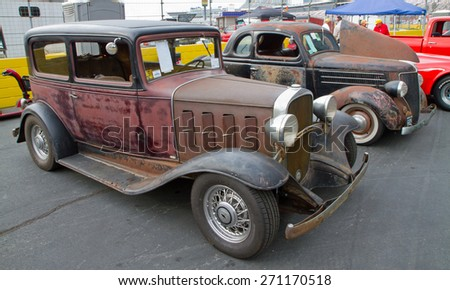 CONCORD, NC -- APRIL 11, 2015:  A 1932 Chevy (foreground) and 1936 Ford on display at the Charlotte AutoFair classic car show held at Charlotte Motor Speedway.