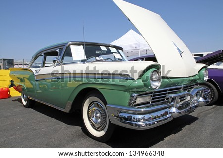 CONCORD, NC - APRIL 6:  A 1957 Ford Fairlane 500 automobile on display at the Food Lion Auto Fair classic car show at Charlotte Motor Speedway in Concord, NC, April 6, 2013. - stock photo