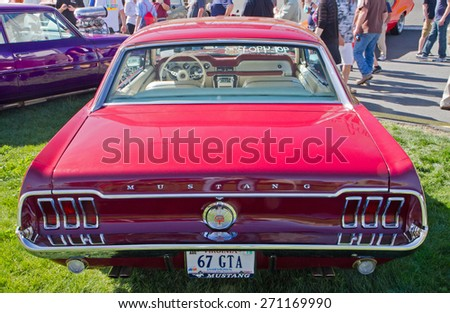 CONCORD, NC -- APRIL 11, 2015:  A 1967 Ford Mustang GT automobile on display at the Charlotte AutoFair classic car show held at Charlotte Motor Speedway. - stock photo