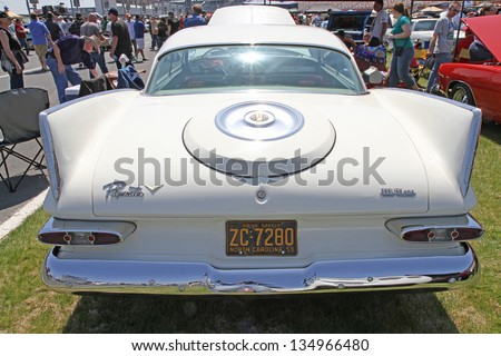 CONCORD, NC - APRIL 6:  A 1959 Plymouth Belevedere automobile on display at the Food Lion Auto Fair classic car show at Charlotte Motor Speedway in Concord, NC, April 6, 2013. - stock photo
