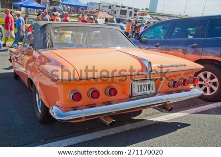 CONCORD, NC -- APRIL 11, 2015:  A 1962 Plymouth Fury convertible automobile on display at the Charlotte AutoFair classic car show held at Charlotte Motor Speedway. - stock photo