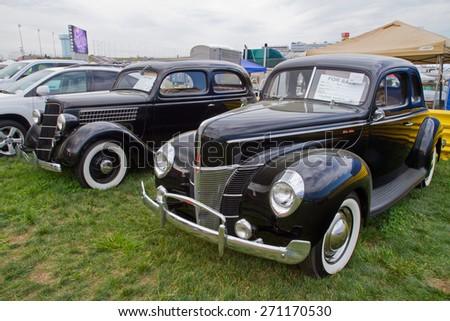 CONCORD, NC -- APRIL 11, 2015:  Classic Ford automobiles on display at the Charlotte AutoFair classic car show held at Charlotte Motor Speedway.