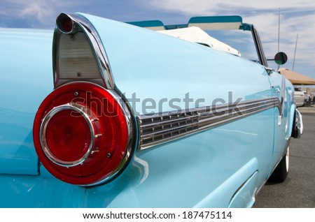 CONCORD, NC -- APRIL 05, 2014:  Closeup of a tail light on a 1956 Ford Fairlane Sunliner on display at the Charlotte AutoFair classic car show held at Charlotte Motor Speedway. - stock photo