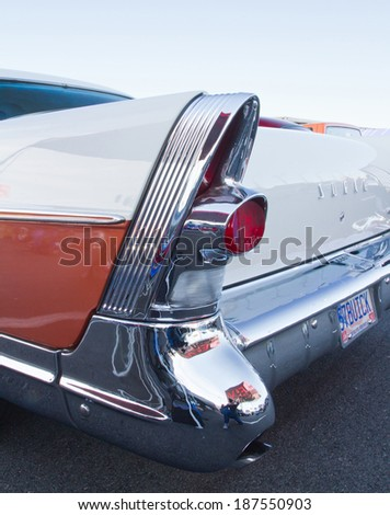 CONCORD, NC -- APRIL 05, 2014:  Closeup of tail fin on a 1957 Buick Super Riviera on display at the Charlotte AutoFair classic car show held at Charlotte Motor Speedway.