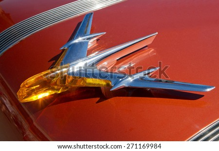 CONCORD, NC -- APRIL 11, 2015:  Hood ornament of a 1955 Pontiac Chieftain automobile on display at the Charlotte AutoFair classic car show held at Charlotte Motor Speedway. - stock photo