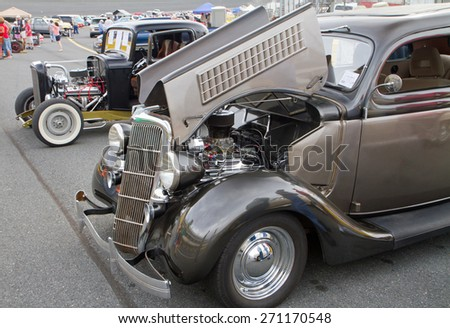 CONCORD, NC -- APRIL 11, 2015:  Two 1930s Ford hot rod automobiles on display at the Charlotte AutoFair classic car show held at Charlotte Motor Speedway. - stock photo