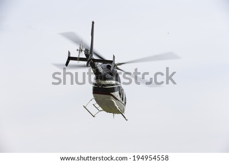 Concord, NC - May 25, 2014:  NASCAR driver, Kurt Busch, boards his Bell Helicopter 429 at Concord Airport to fly to Charlotte Motor Speedway to run the Coca-Cola 600 NASCAR race at Concord, NC.  - stock photo