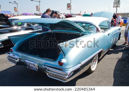 CONCORD, NC -- SEPTEMBER 20, 2014:  A 1958 Cadillac Eldorado Seville automobile on display at the Charlotte AutoFair classic car show held at Charlotte Motor Speedway. - stock photo