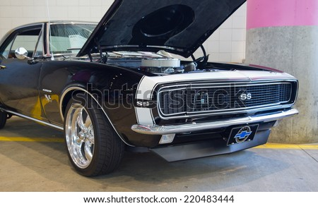 CONCORD, NC -- SEPTEMBER 20, 2014:  A 1967 Chevy Camaro SS automobile on display at the Charlotte AutoFair classic car show held at Charlotte Motor Speedway. - stock photo